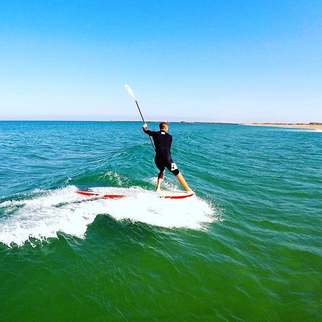 Remy Sanchez - Guide de Surf Anglet SUP Pagaie en l'air de dos